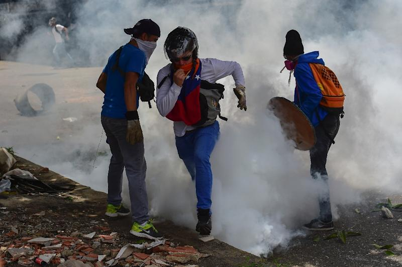 Caracas has been rocked by weeks of violent protests since President Nicolas Maduro moved to tighten his grip on power, escalating the country's political and economic crisis (AFP Photo/RONALDO SCHEMIDT)