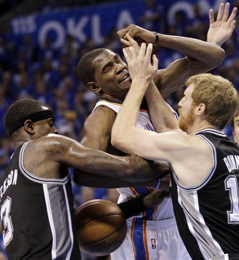 Oklahoma City Thunder small forward Kevin Durant, center, runs into San Antonio Spurs' Stephen Jackson (3) and and Matt Bonner (15) during the first half of Game 3 in their NBA basketball Western Conference finals playoff series, Thursday, May 31, 2012, in Oklahoma City. (AP Photo/Sue Ogrocki)