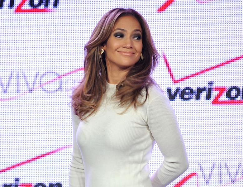 FILE - This May 22, 2013 file photo shows actress and recording artist Jennifer Lopez at a news conference announcing Viva Movil by Jennifer Lopez in Las Vegas. Lopez says Latinos in the United States are starting to realize their power in politics and media, and that makes the timing good for her latest undertaking: Lobbying for greater diversity in TV programming. The actress and entertainer spoke Wednesday, June 12, at the Cable Show, a communications convention, ahead of new programming set to launch July 18 on the NUVOtv network. Lopez serves as chief creative officer of the English-language Latino channel. (Photo by Jeff Bottari/Invision/AP, file)