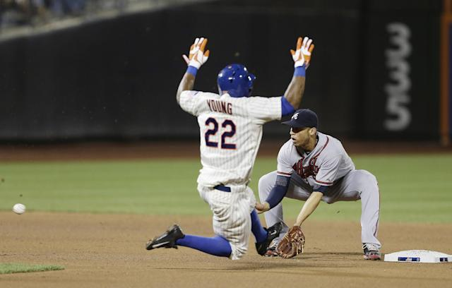 New York Mets' Eric Young Jr. (22) attempts to steal second base as Atlanta Braves' Andrelton Simmons waits for the ball during the seventh inning of a baseball game Tuesday, July 23, 2013, in New York. Young was out on the play. (AP Photo/Frank Franklin II)