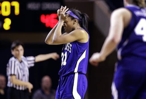 Holy Cross forward Raquel Scott reacts after being called for traveling during the second half of an NCAA college basketball game against Navy in the championship of the Patriot League women's tournament in Annapolis, Md., Saturday, March 16, 2013. Navy won 72-53. (AP Photo/Patrick Semansky)