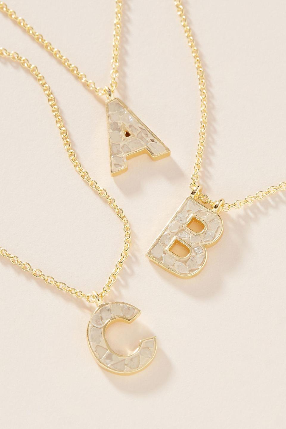"""<br><br><strong>Collections by Joya</strong> Deco Diamond Monogram Pendant Necklace, $, available at <a href=""""https://go.skimresources.com/?id=30283X879131&url=https%3A%2F%2Fwww.anthropologie.com%2Fshop%2Fdeco-diamond-monogram-pendant-necklace"""" rel=""""nofollow noopener"""" target=""""_blank"""" data-ylk=""""slk:Anthropologie"""" class=""""link rapid-noclick-resp"""">Anthropologie</a>"""