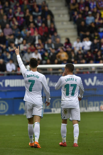 Real Madrid's Cristiano Ronaldo celebrates his second goal beside Lucas Vazquez after scoring during the Spanish La Liga soccer match between Real Madrid and SD Eibar at Ipurua stadium, in Eibar, northern Spain, Saturday, March 10, 2018. (AP Photo/Alvaro Barrientos)