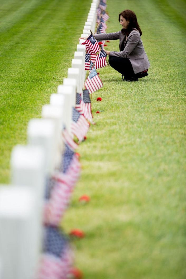 """<p>Pay tribute to those who have lost their lives fighting for our country by visiting a nearby <a href=""""https://www.cem.va.gov/cems/listcem.asp"""" rel=""""nofollow noopener"""" target=""""_blank"""" data-ylk=""""slk:veterans' cemetery"""" class=""""link rapid-noclick-resp"""">veterans' cemetery</a>, where you can place flags and flowers on the graves.</p>"""