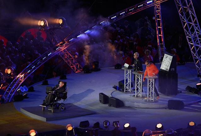 LONDON, ENGLAND - AUGUST 29: Phil and Paul Hartnoll of Orbital perform with Professor Stephen Hawking during the Opening Ceremony of the London 2012 Paralympics at the Olympic Stadium on August 29, 2012 in London, England. (Photo by Dennis Grombkowski/Getty Images)