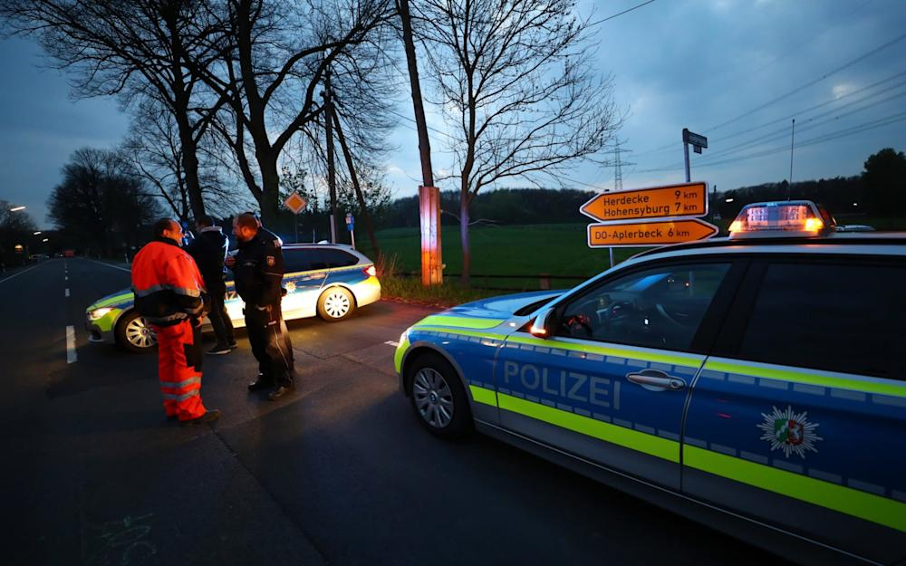 Police near the Borussia Dortmund team hotel after the explosion - Credit: Reuters