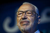 """File - In this Oct. 3, 2019, photo, Islamist party leader and parliament speaker Rached Ghannouchi speaks during a meeting in Tunis, Tunisia. Rached Ghannouchi said on Tuesday that his party is working to form a """"national front"""" to counter President Kais Saied's decision to suspend the legislature, fire top government officials and take control of the fragile democracy amid the country's multi-layered crisis. (AP Photo/Hassene Dridi, File)"""