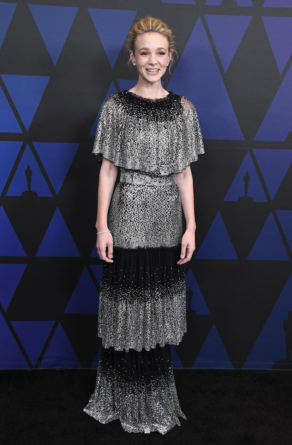 <p>Carey wore a Dolce & Gabbana tiered gown paired with white diamond jewellery from Tiffany & Co at the 10th annual Governors Awards at the Ray Dolby Ballroom in Los Angeles. <em>[Photo: Getty]</em> </p>