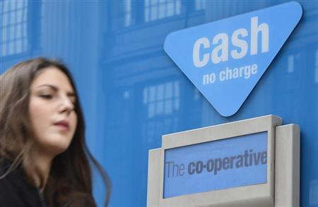 A woman walks past a branch of the Co-operative Bank in central London