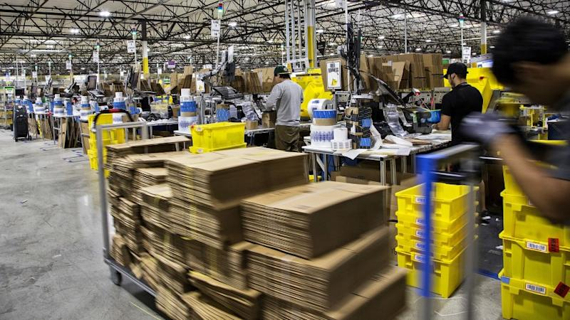 SAN BERNARDINO, CA - NOVEMBER 28, 2016: Workers quickly pack items on Cyber Monday at the Amazon Ful