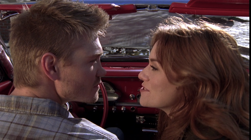 Lucas and Peyton in the comet about to leave town