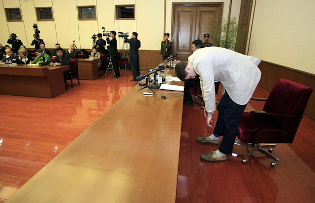<p>U.S. student Otto Warmbier, right, bows as Warmbier is presented to the reporters on Monday, Feb. 29, 2016, in Pyongyang, North Korea. (Photo: Kim Kwang Hyon/AP) </p>