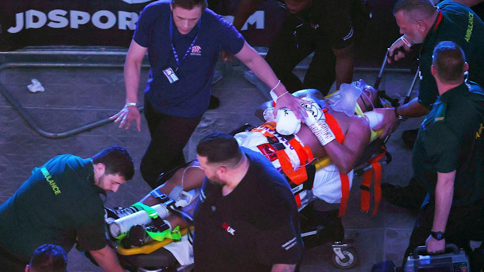 Paramedics and medical staff, pictured here stretchering Lenin Castillo out of the arena.