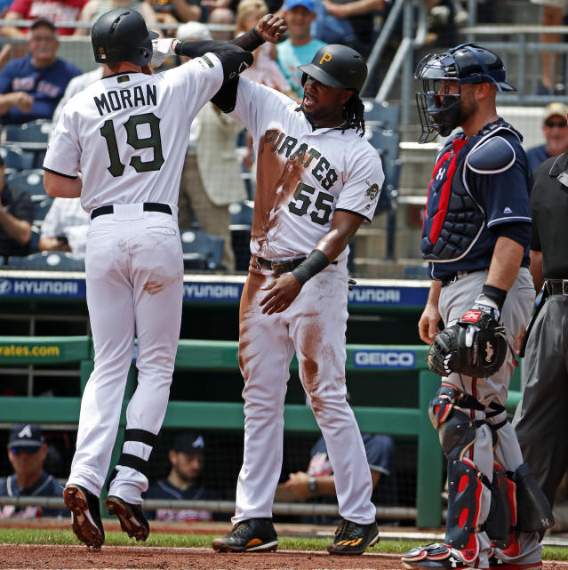 Pittsburgh Pirates' Colin Moran (19) is greeted by Josh Bell (55) after hitting a two-run home run off Atlanta Braves starting pitcher Mike Foltynewicz in the second inning of the team's baseball game in Pittsburgh, Thursday, June 6, 2019. (AP Photo/Gene J. Puskar)