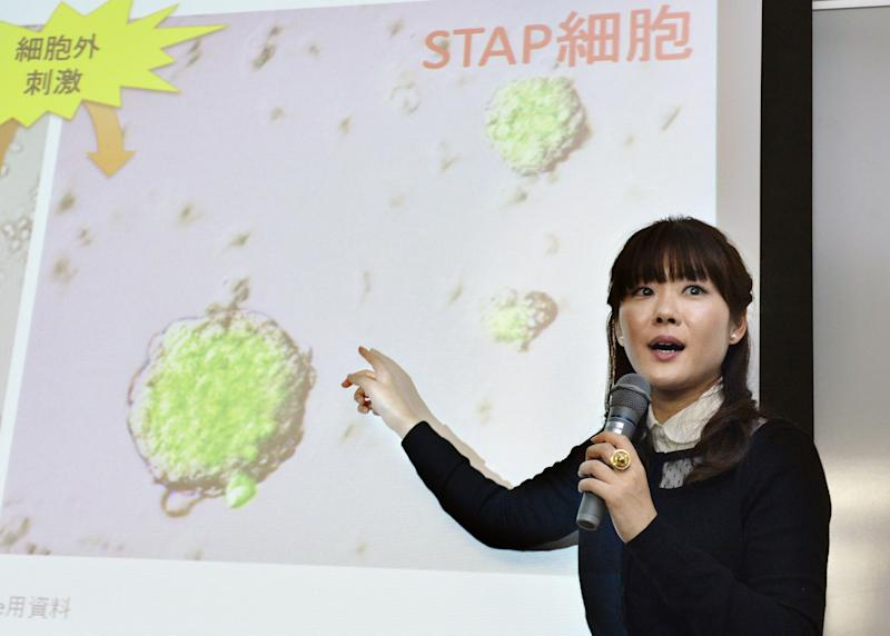 In this Jan. 28, 2014 photo, Japanese government-funded laboratory Riken Center for Development Biology researcher Haruko Obokata, the lead author of a widely heralded stem-cell research paper, speaks about her research results on stimulus-triggered acquisition of pluripotency (STAP) cells during a press conference in Kobe, western Japan. Scientists at the institute said Tuesday, April 1, that discrepancies in research published in January in scientific journal Nature stemmed from image manipulation and data fabrication. They said Obokata had manipulated or falsified images of DNA fragments used in the research. (AP Photo/Kyodo News) JAPAN OUT, MANDATORY CREDIT