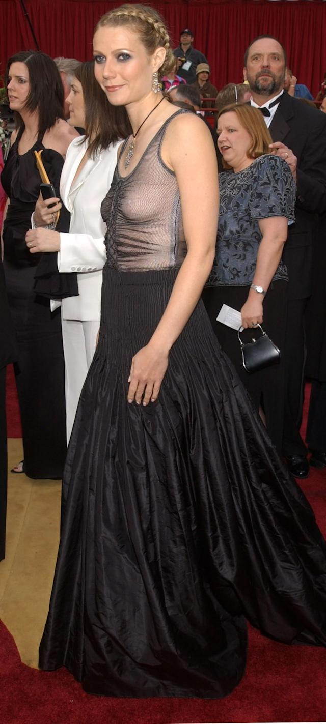 "<p>Gwyneth took a lot of flack from the tabloids for this braless 2002 Alexander McQueen look, and <a href=""http://www.vogue.co.uk/gallery/gwyneth-paltrow-oscars-dress-worst-dressed-red-carpet-fashion-faux-pas"" rel=""nofollow noopener"" target=""_blank"" data-ylk=""slk:later admitted to Vogue"" class=""link rapid-noclick-resp"">later admitted to <em>Vogue</em></a> it wasn't her favorite. ""There were a few issues,"" she said. ""I still love the dress itself, but I should have worn a bra and I should have just had simple beachy hair and less makeup. Then, it would have worked as I wanted it to — a little bit of punk at the Oscars."" (Photo: Vince Bucci/Getty Images) </p>"