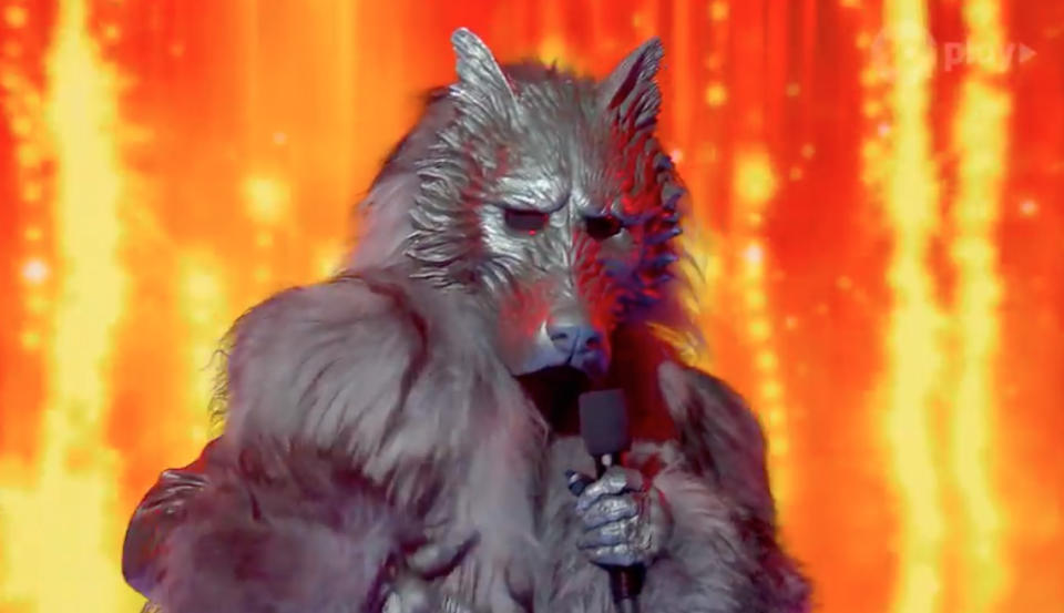 The Wolf character performs on The Masked Singer