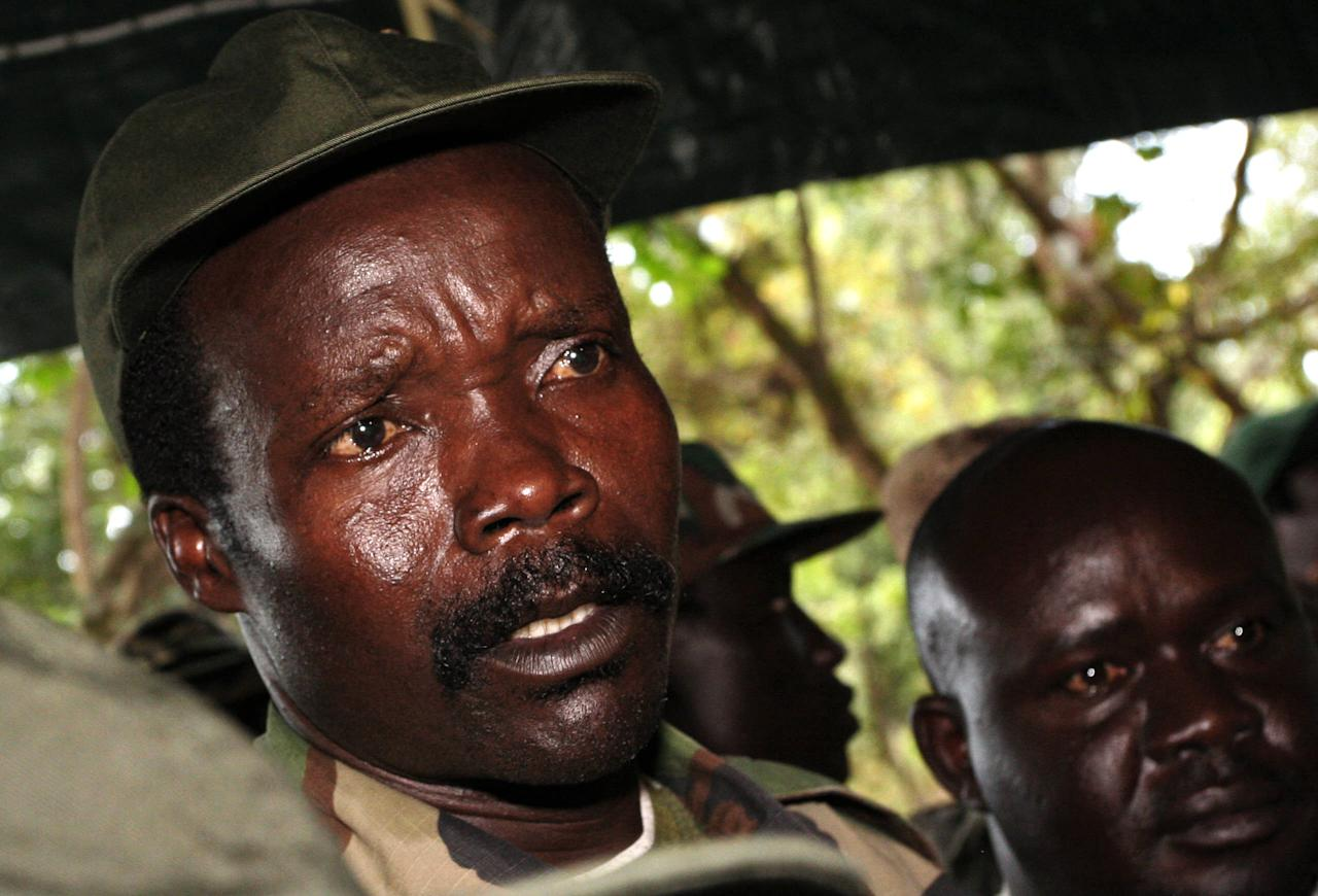 FILE - In this Nov. 12, 2006 file photo, the leader of the Lord's Resistance Army, Joseph Kony answers journalists' questions following a meeting with UN humanitarian chief Jan Egeland at Ri-Kwamba in southern Sudan. A senior U.S. military official confirmed Monday, March 24, 2014 that the U.S. is sending at least four CV-22 Osprey aircraft and about 150 more Air Force special operations members and airmen to assist African forces in their long-running battle against Kony's Lord's Resistance Army, (LRA) (AP Photo/Stuart Price, Pool, File)