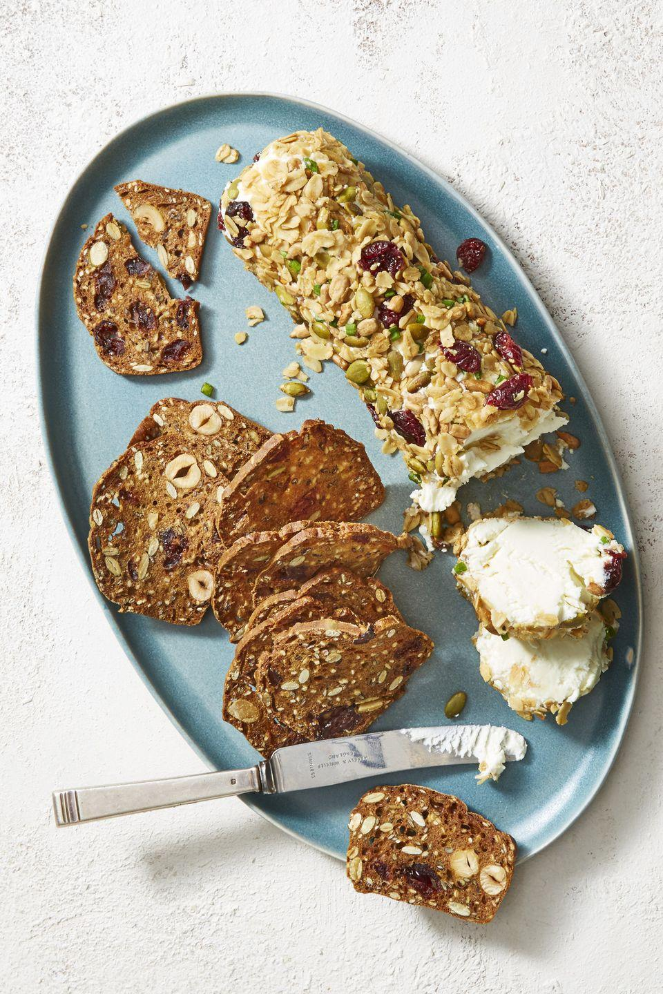 """<p>Nothing tops a tray of cheese and <a href=""""https://www.goodhousekeeping.com/food-recipes/easy/a22657016/saltine-crackers-recipe/"""" rel=""""nofollow noopener"""" target=""""_blank"""" data-ylk=""""slk:crackers"""" class=""""link rapid-noclick-resp"""">crackers</a> ... well, unless it's a whole log of cheese. </p><p><em><a href=""""https://www.goodhousekeeping.com/food-recipes/party-ideas/a22750509/goat-cheese-log-with-cranberries-chives-and-black-pepper-recipe/"""" rel=""""nofollow noopener"""" target=""""_blank"""" data-ylk=""""slk:Get the recipe for Goat Cheese Log With Cranberries, Chives and Black Pepper »"""" class=""""link rapid-noclick-resp"""">Get the recipe for Goat Cheese Log With Cranberries, Chives and Black Pepper »</a></em></p>"""