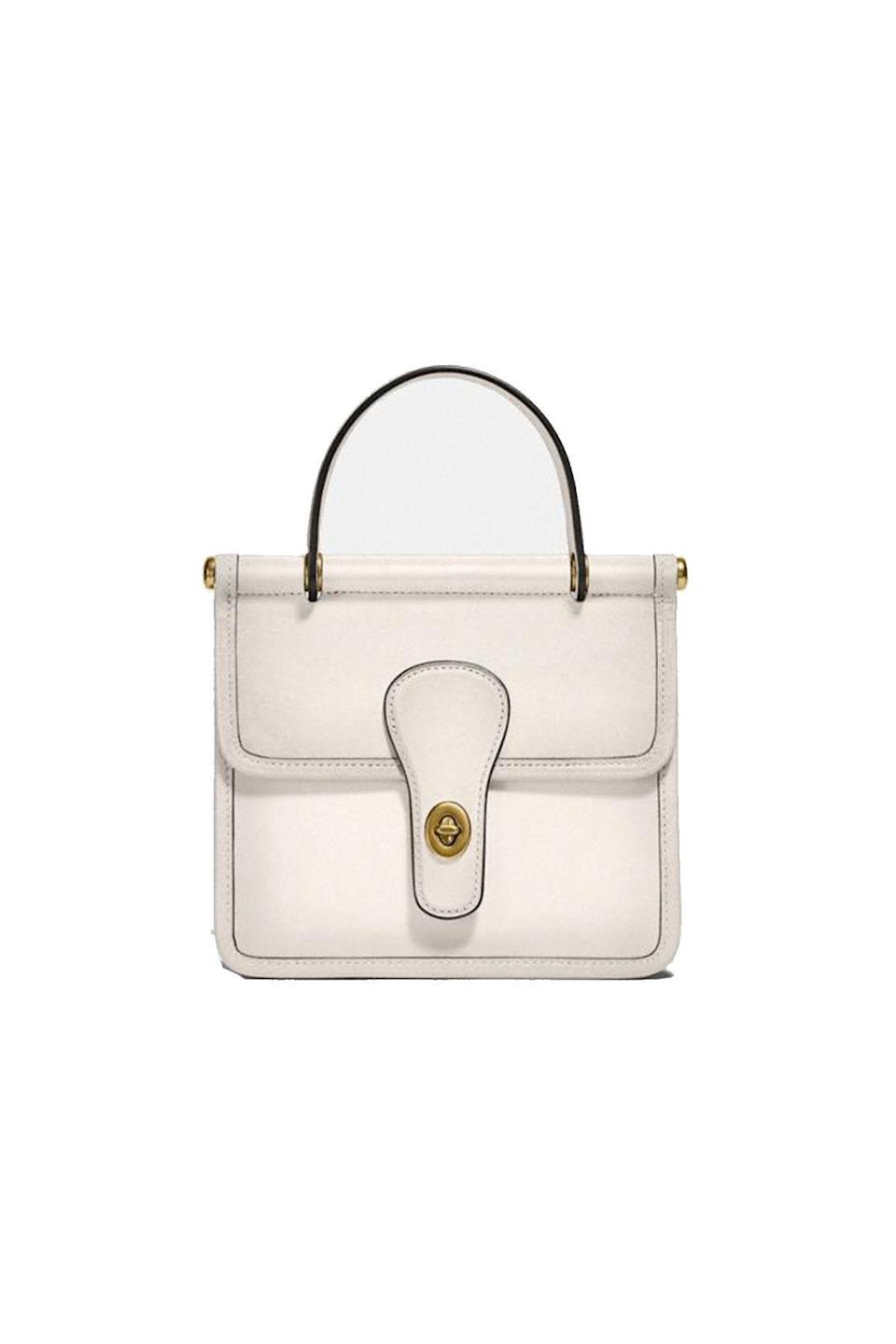 """<p><strong>Coach</strong></p><p>coach.com</p><p><strong>$350.00</strong></p><p><a href=""""https://go.redirectingat.com?id=74968X1596630&url=https%3A%2F%2Fwww.coach.com%2Fcoach-willis-top-handle-18%2F5789.html%3Fdwvar_color%3DB4%252FHA&sref=https%3A%2F%2Fwww.townandcountrymag.com%2Fstyle%2Ffashion-trends%2Fg22576837%2Ffall-outfits%2F"""" rel=""""nofollow noopener"""" target=""""_blank"""" data-ylk=""""slk:Shop Now"""" class=""""link rapid-noclick-resp"""">Shop Now</a></p>"""