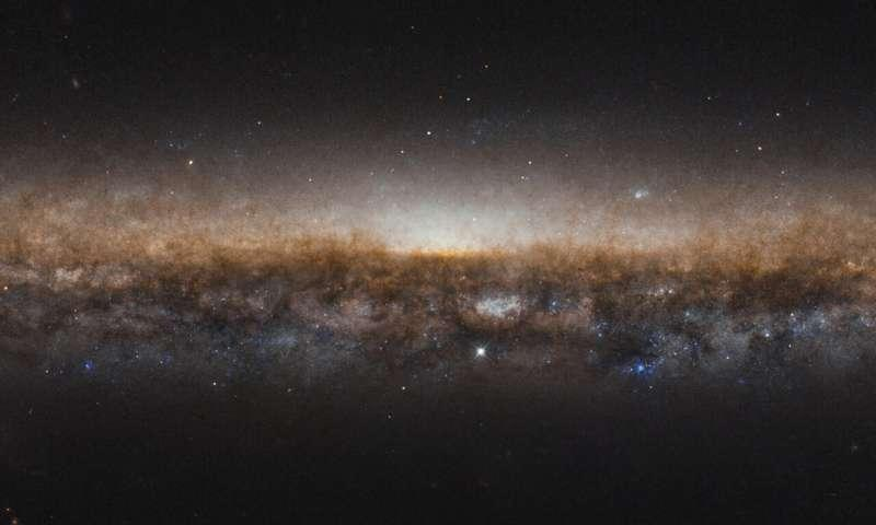 This new image, taken by the NASA/ESA Hubble Space Telescope, shows the incredible stretch of the galaxy NGC 5907, also known as the Knife Edge galaxy. This is a spiral galaxy, much like our home galaxy, the Milky Way. Though, you can't see the galaxy's brilliant spiral shape in this image as this image was taken facing the galaxy's edge.