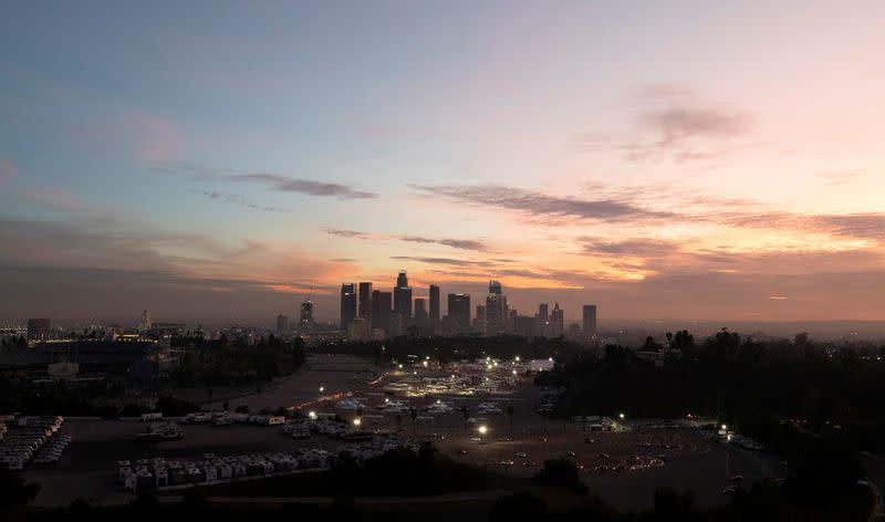 FILE PHOTO: Vehicles line up at at Dodger Stadium COVID-19 vaccination site at sunset during the outbreak of the coronavirus disease (COVID-19), in Los Angeles