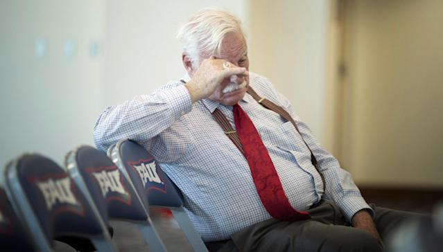 Howard Schnellenberger, Florida Atlantic football program's founder and longtime coach, listens to athletic director Patrick Chun as he talks to the media during a news conference Wednesday, Oct. 30, 2013, in Boca Raton, Fla. Florida Atlantic coach Carl Pelini and defensive coordinator Pete Rekstis both resigned Wednesday after acknowledging to university officials that they had used illegal drugs. (AP Photo/J Pat Carter)