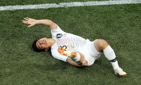 FILE PHOTO: South Korea's Park Joo-ho lies on the pitch injured in the World Cup Group F match against Sweden on June 18, 2018 in Nizhny Novgorod. REUTERS/Lucy Nicholson/File Photo