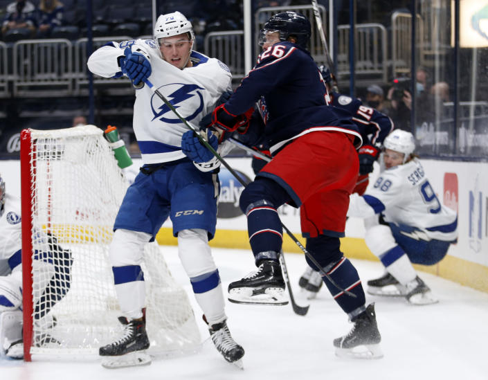 Tampa Bay Lightning forward Ross Colton, left, gets crossed up with Columbus Blue Jackets forward Zac Dalpe during the second period of an NHL hockey game in Columbus, Ohio, Thursday, April 8, 2021. (AP Photo/Paul Vernon)