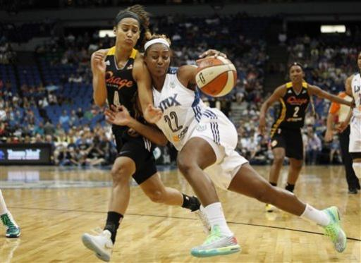 Minnesota Lynx guard Monica Wright (22) pushes the ball across the court against Tulsa Shock guard Skylar Diggins (4) in the second half of a WNBA basketball game, Sunday, June 23, 2013, in Minneapolis. The Lynx won 88-79. (AP Photo/Stacy Bengs)