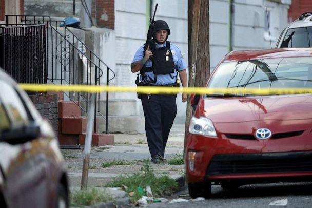 PHOTO: A police officer patrols the block near a house as they investigate an active shooting situation, Aug. 14, 2019, in the Nicetown neighborhood of Philadelphia. (Matt Rourke/AP)