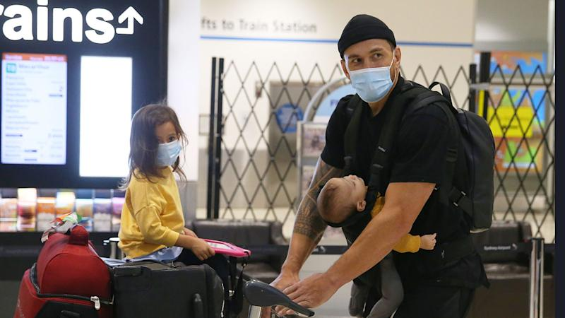 Seen here, Sonny Bill Williams with his two children after arriving in Australia.