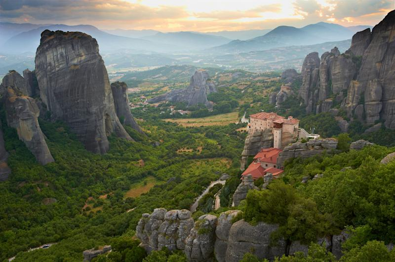 """The Roussanou Monastery is one of <a href=""""http://www.cnn.com/travel/article/meteora-greece/index.html"""" target=""""_blank"""">six precarious religious sites</a>that rise out of Greece's rock cliffs. The cliffs were first inhabited in the 9th century by hermit monks. Centuries later, the secluded rock pillars provided monks with protection from political upheaval. Although the Meteora rock formationonce held 20 monasteries, only six survive today."""