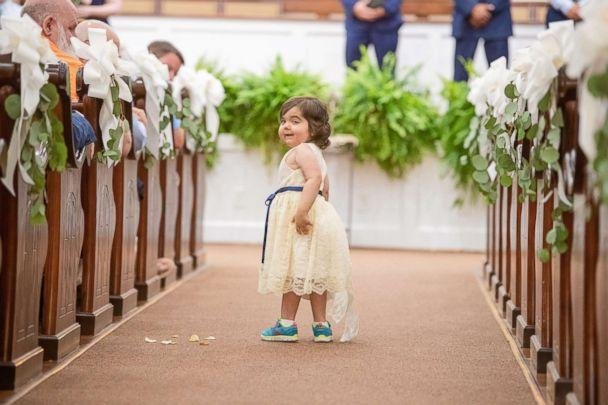 PHOTO: Skye Savren-McCormick, 3, walks down the aisle as the flower girl for her bone marrow donor's wedding on June 9, 2018. (Mark Broadway Photography)