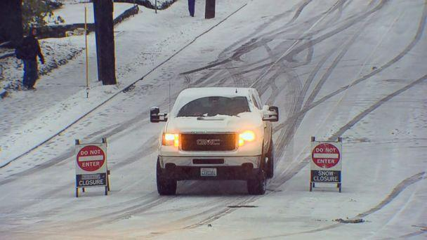 PHOTO: A truck drives on a snow covered road early in the morning in Seattle, Feb. 4, 2019. (KOMO)