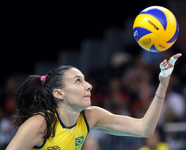 LONDON, ENGLAND - AUGUST 01:  Sheilla Castro #13 of Brazil serves to Korea in the second set during Women's Volleyball on Day 5 of the London 2012 Olympic Games at Earls Court on August 1, 2012 in London, England.  (Photo by Elsa/Getty Images)