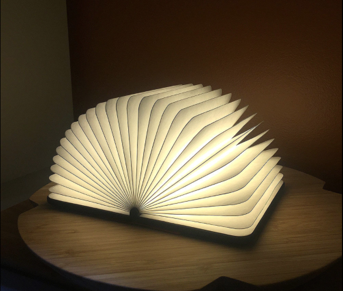 This Lumio light conceals itself in a hard-cover book, opening out 360 degrees to illuminate your room. Photo: Top3