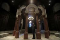 A museum worker takes pictures on a mobile phone of one of the reconstructed halls at the Sursock Museum that was damaged from the massive explosion in the nearby Beirut port, in Beirut, Lebanon, July 27, 2021. Lebanon's only modern art museum is still rebuilding a year after the explosion decimated it. (AP Photo/Hussein Malla)