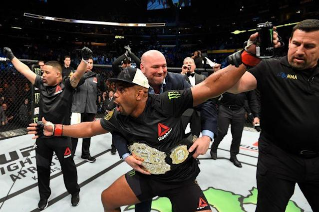 Daniel Cormier shouts at someone near the Octagon after defeating Anthony Johnson. (Getty Images)