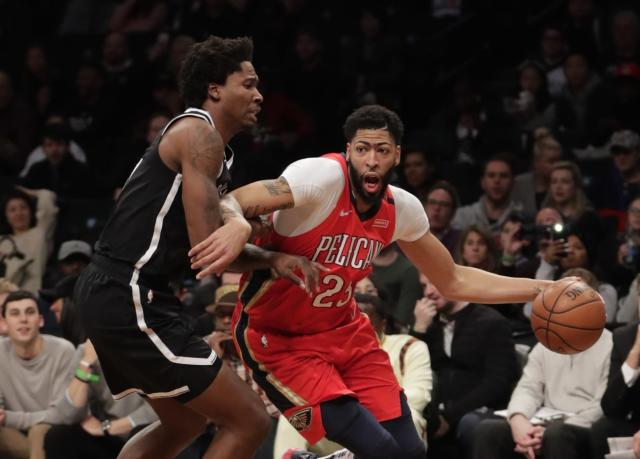 Anthony Davis drives against the Nets' Ed Davis during an early January game. (AP)