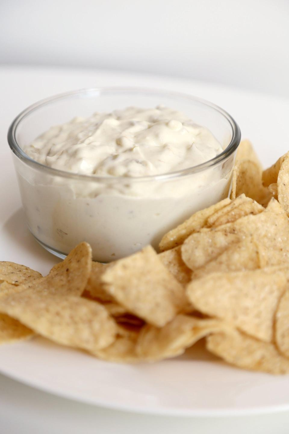 "<p>OK, so this isn't a prepackaged queso from Trader Joe's. But it's made with four cheap ingredients from Trader Joe's (cream cheese, smoked cheddar, fire-roasted diced green chiles, and half and half) and is crazy delicious. </p> <p><strong>Get the recipe:</strong> <a href=""https://www.popsugar.com/food/How-Microwave-Queso-Dip-40080587"" class=""link rapid-noclick-resp"" rel=""nofollow noopener"" target=""_blank"" data-ylk=""slk:microwave queso recipe"">microwave queso recipe</a></p>"
