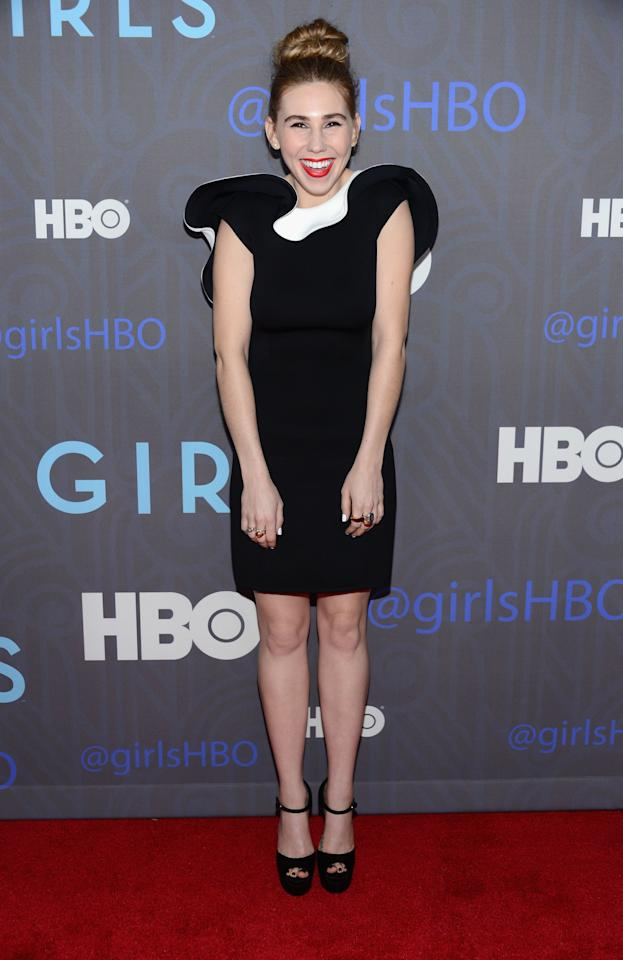 <p>Mamet steps it up a notch in lipstick and a floppy statement dress at the premiere of <em>Girls</em> season two in New York, January 2013.</p>