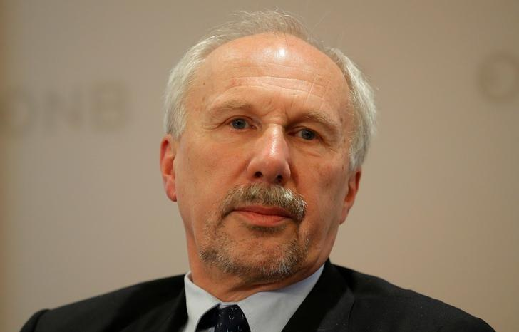 ECB Governing Council member Nowotny listens during a news conference in Vienna