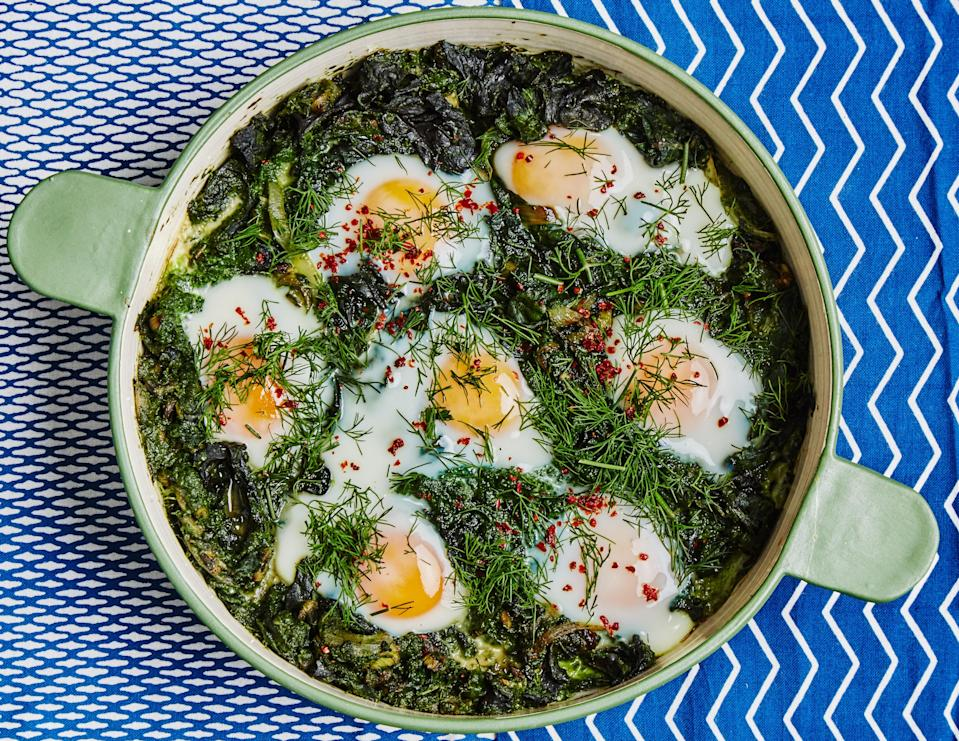 """Say that three times fast! Watch closely toward the end of the cooking time and remove from oven when the eggs have plenty of wobble left in them. <a href=""""https://www.bonappetit.com/recipe/green-shakshuka?mbid=synd_yahoo_rss"""" rel=""""nofollow noopener"""" target=""""_blank"""" data-ylk=""""slk:See recipe."""" class=""""link rapid-noclick-resp"""">See recipe.</a>"""