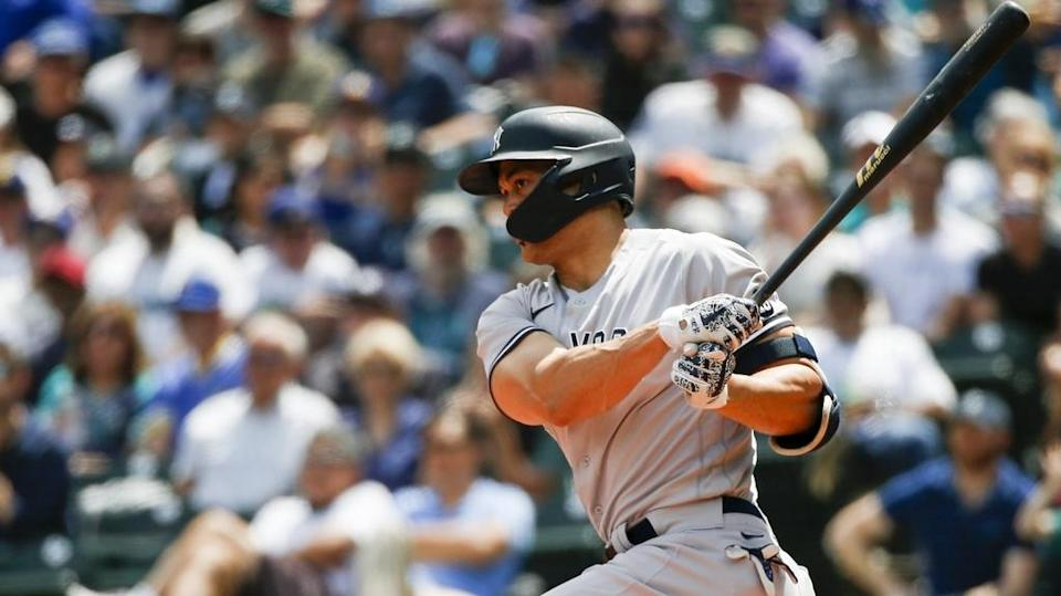 Jul 8, 2021; Seattle, Washington, USA; New York Yankees designated hitter Giancarlo Stanton (27) hits a single against the Seattle Mariners during the second inning at T-Mobile Park.