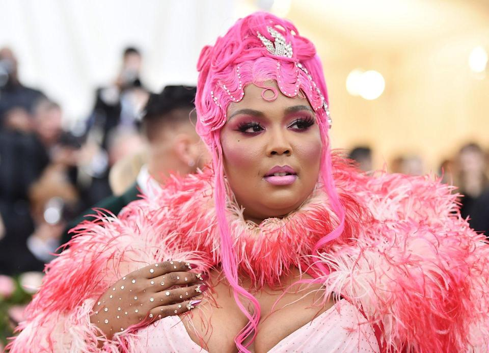 """<p>Singer and rapper Lizzo matched her bejeweled updo with the pink flamingo carpet at the <a href=""""https://www.oprahmag.com/style/g27379808/all-met-gala-red-carpet-dresses-2019/"""" rel=""""nofollow noopener"""" target=""""_blank"""" data-ylk=""""slk:2019 Met Gala"""" class=""""link rapid-noclick-resp"""">2019 Met Gala</a>. </p><p>For a more subtle approach, a dusty rose color, blending the pink, while keeping the tones muted, creates a more natural look that also adds movement.</p>"""