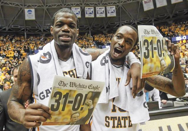 Wichita State's Chadrack Lufile, left, and Nick Wiggins celebrate their perfect 31-0 season after defeating Missouri State 68-45 in an NCAA college basketball game in Wichita, Kan., Saturday, March 1, 2014. (AP Photo/The Wichita Eagle, Fernando Salazar)