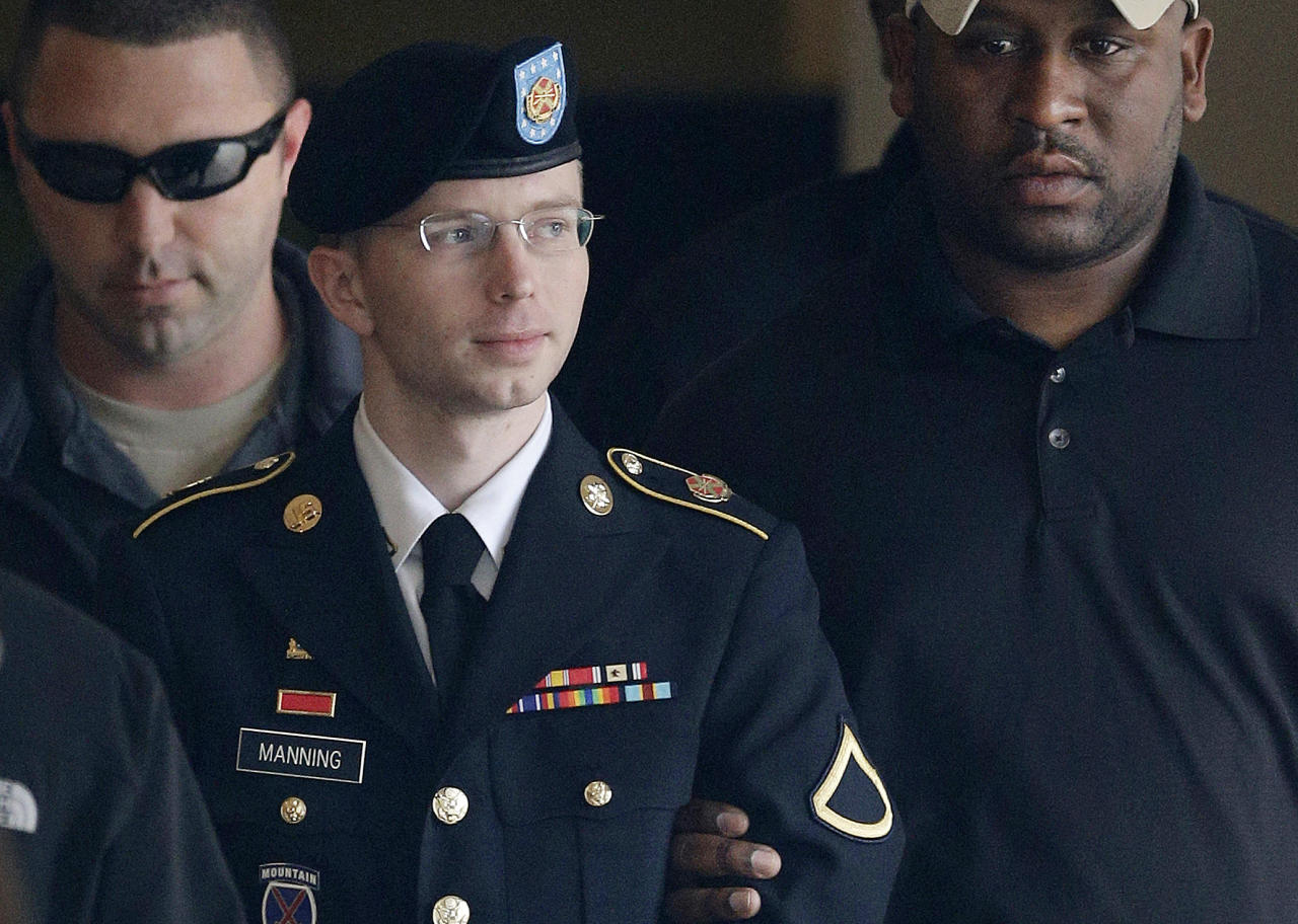 FILE - In this Tuesday, Aug. 20, 2013, file photo, Army Pfc. Bradley Manning is escorted to a security vehicle outside a courthouse in Fort Meade, Md., after a hearing in his court martial. A northeast Kansas judge will make a final determination Wednesday, April 23, 2014, on Manning's request to change her name from Bradley Edward Manning to Chelsea Elizabeth Manning. Manning is serving a 35-year sentence for giving reams of classified U.S. government information to the anti-secrecy website WikiLeaks. (AP Photo/Patrick Semansky, File)