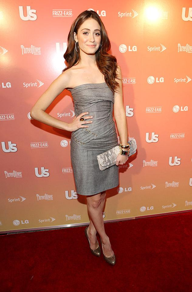 """On the other hand, Emmy Rossum looked fabulous in a gray grommet-enhanced wrap dress, chunky jewelry, and bronze heels. Bennett Raglin/<a href=""""http://www.wireimage.com"""" target=""""new"""">WireImage.com</a> - September 16, 2009"""