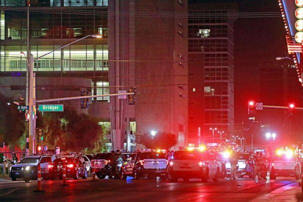 PHOTO: Police and rescue workers swarm the intersection outside Lloyd D. George Federal Courthouse, where shots were fired late Monday, June 1, 2020, in downtown Las Vegas. (Ronda Churchill/AP)